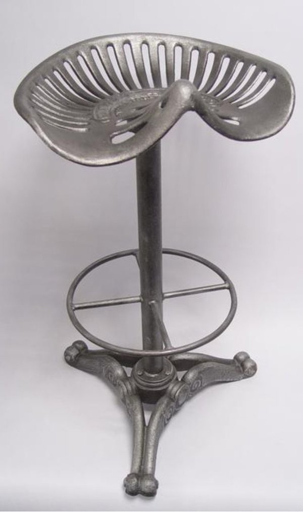 A CAST IRON BAR STOOL, OLD SILVER